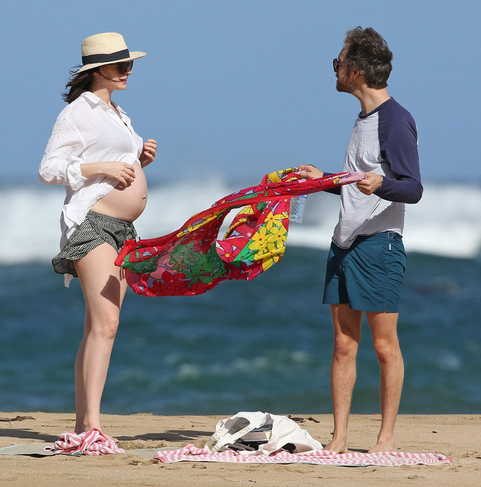 *PREMIUM EXCLUSIVE RATES APPLY* *NO WEB UNTIL 8.30AM PST, JANUARY 5. NO NY PAPERS*A bikini clad Anne Hathaway shows off her growing baby bump while SPENDING CHRISTMAS AND NEW YEAR with her husband Adam Shulman in Hawaii. Shot on Dec 27